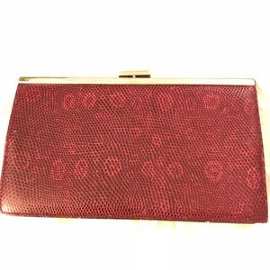 J Crew red leather clutch with silver chain.